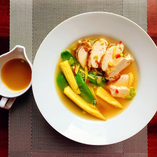 Green tea and ginger clear soup with chicken and steamed vegetables